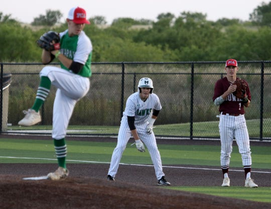 Iowa Park's Kase Johnson takes a lead next to Bowie's Evan Kennedy at the Fellowship of Christian Athletes baseball game Thursday, June 13, 2019, in Iowa Park.