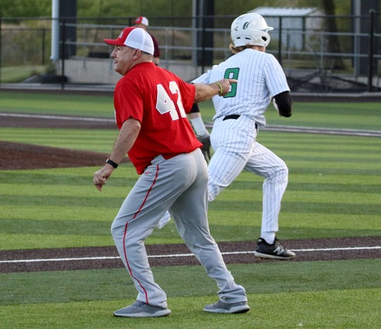 Head coach Terry Wolf sends Iowa Park's Kase Johnson home at the Fellowship of Christian Athletes baseball game Thursday, June 13, 2019, in Iowa Park.