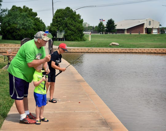 Stephen Poirot spent Friday morning fishing with his grandsons Madix Poirot, 6, and Tanner Poirot, 13, at the pond at South Weeks Park off Southwest Parkway.