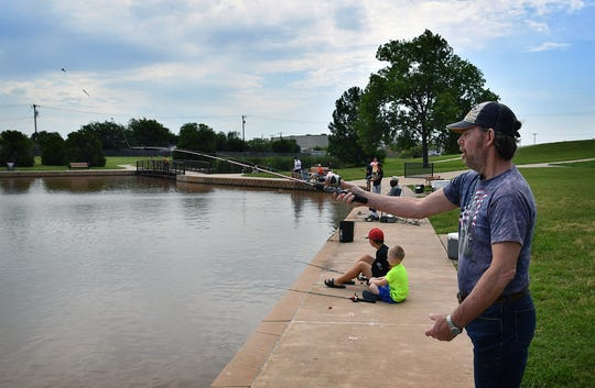 Brian Dowlearn casts his line out while participating in a fishing excursion day with University Park Nursing and Rehab Friday at the pond at South Weeks Park.