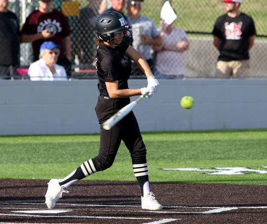 Henrietta's Kaci Williams makes contact at the Fellowship of Christian Athletes softball game Thursday, June 13, 2019, in Iowa Park.