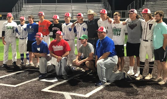 Red coach Terry Wolf (first row in red) and his former Crush players, several of who played in Thursday's FCA baseball all-star game.