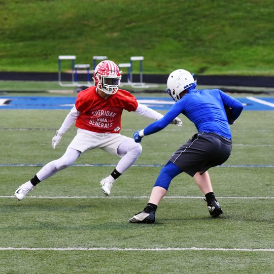 Sheridan's Cole Casto tries to tackle a receiver during Muskingum Valley All-Star practice on Thursday at John D. Sulsberger Memorial Stadium in Zanesville.