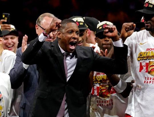 Raptors president Masai Ujiri celebrates on the court.