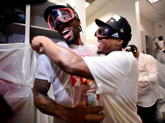 Kawhi Leonard and Kyle Lowry celebrate in the locker room.