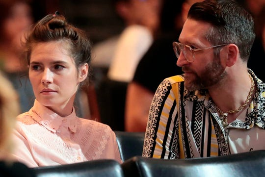 Amanda Knox and her fiancee Christopher Robinson attend a conference during a Criminal Justice Festival at the University of Modena, Italy, Friday, June, 2019.