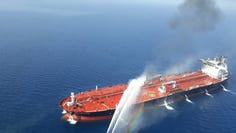 TOPSHOT - A picture obtained by AFP from Iranian news agency Tasnim on June 13, 2019 reportedly shows an Iranian navy boat trying to control fire from Norwegian owned Front Altair tanker said to have been attacked in the waters of the Gulf of Oman. - Suspected attacks left two tankers in flames in the waters of the Gulf of Oman today, sending world oil prices soaring as Iran helped rescue stricken crew members. The mystery incident, the second involving shipping in the strategic sea lane in only a few weeks, came amid spiralling tensions between Tehran and Washington, which has pointed the finger at Iran over earlier tanker attacks in May.Subject : IRAN OIL TANKER 5 (Photo by - / TASNIM NEWS / AFP)-/AFP/Getty Images ORIG FILE ID: AFP_1HH6NY