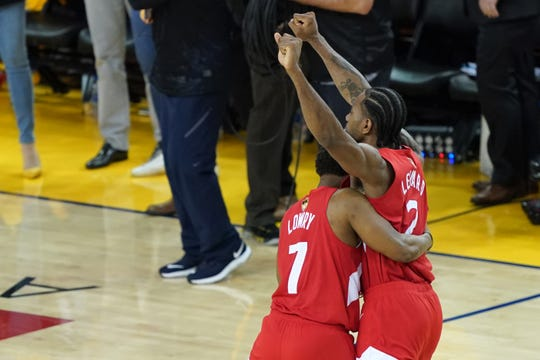 Kyle Lowry and Kawhi Leonard celebrate after winning the NBA Finals.