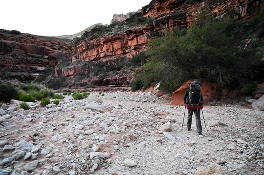 A hiker makes his way through a canyon on the Havasupai Indian Reservation.