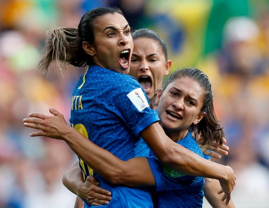June 13: Marta Vieira Da Silva, left, after scoring for Brazil against Australia.