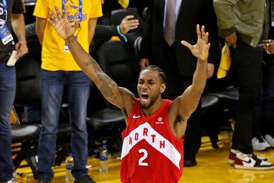 Kawhi Leonard celebrates beating the Warriors in Game 6 of the NBA Finals.