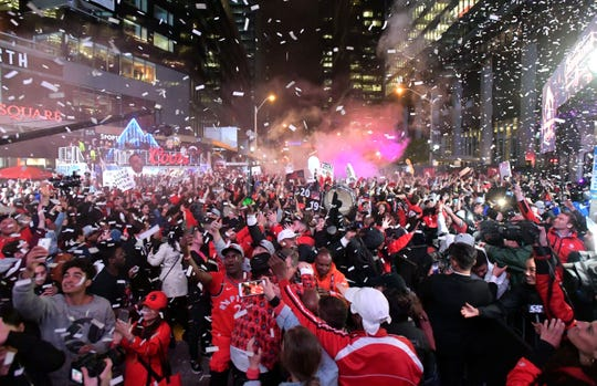 Raptors fans celebrate at the Jurassic Park watch party at Scotiabank Arena.