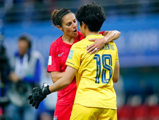 Carli Lloyd talks with Thailand goalkeeper Sukanya Chor Charoenying after their June 11 match.