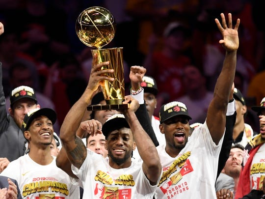 Raptors players celebrate after winning the NBA Finals.