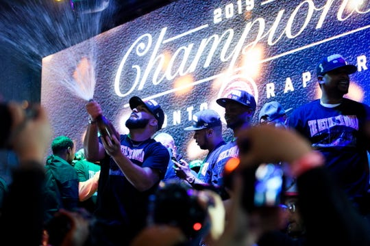 Drake sprays champagne on stage in Jurassic Park near Scotiabank Arena in Toronto.