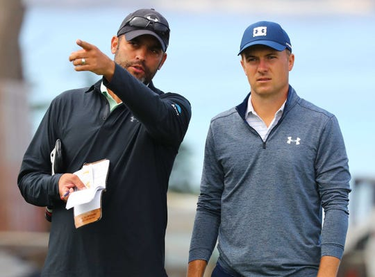 Jun 12, 2019; Pebble Beach, CA, USA; Caddie Michael Greller talks to Jordan Spieth at the 11th hole during a practice round of the 2019 U.S. Open golf tournament at Pebble Beach Golf Links. Mandatory Credit: Rob Schumacher-USA TODAY Sports