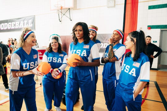 Former First Lady Michelle Obama, third from left, leads a U.S. dodgeball team that includes Kate Hudson, left, Meliisa McCarthy, Allison Janney, Lena Waithe and Mila Kunis. They play a U.K. team on 'The Late Late Show' on Monday.