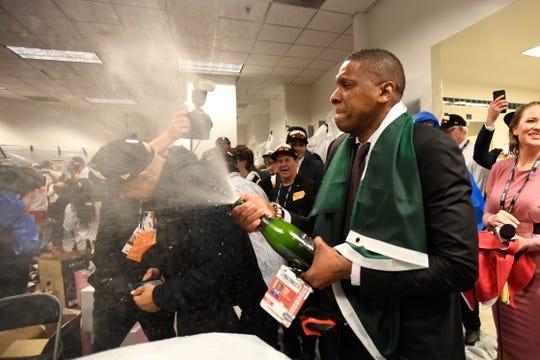 Raptors president Masai Ujiri celebrates in the locker room.