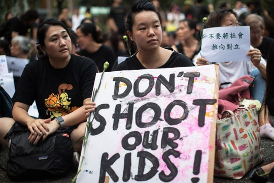 A group of Hong Kong mothers attend a rally in Hong Kong on June 14, 2019.