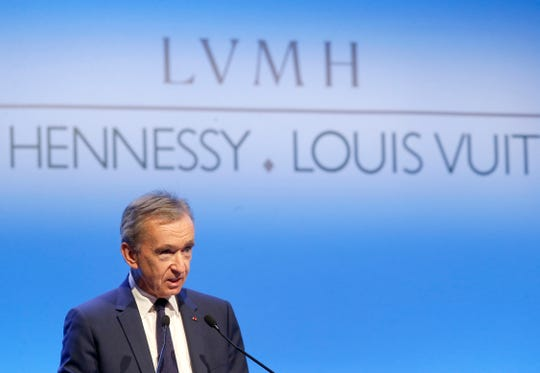 CEO of LVMH Bernard Arnault presents the group's 2017 results in Paris, France. The billionaire French donors including Bernard Arnault, CEO of luxury giant LVMH that owns Louis Vuitton and Dior, publicly promised flashy donations.
