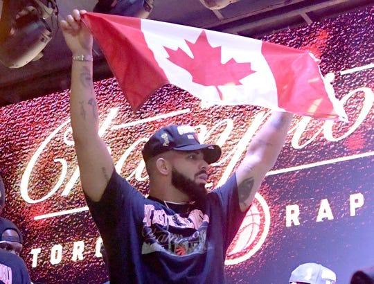Drake reacts with Raptors fans at the Jurassic Park watch party.