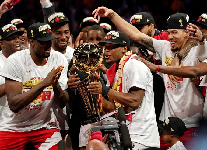Game 6: Kyle Lowry kisses the Larry O'Brien Trophy after the Raptors clinched the first championship in team history.
