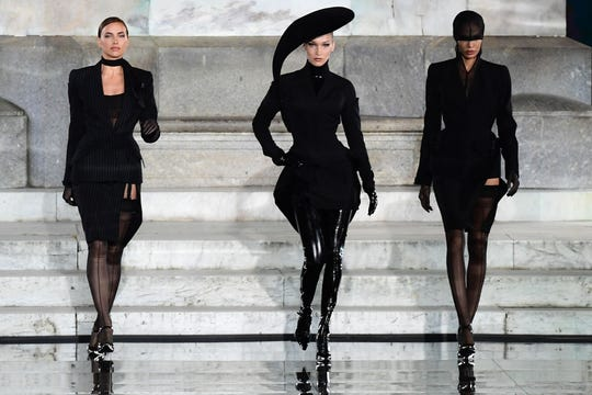 Irina Shayk, Bella Hadid and Joan Smalls present a creation during the presentation of French fashion editor Carine Roitfeld's CR Runway concept with Italian luxury retailer LuisaViaRoma, on the Piazzale Michelangelo esplanade on June 13, 2019 within the Pitti Immagine Uomo fashion fair in Florence.