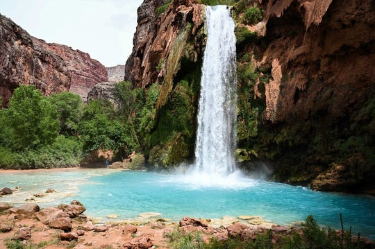 Havasu Falls is a striking blue-green waterfall that greets visitors to the Havasupai campground. The turquoise water is created by a high concentration of lime.
