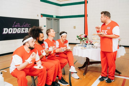 U.K. dodgeball team captain James Corden, right, presents a different kind of training table during 'The Late Late Show' dodgeball match against Team USA. The U.K. team features John Bradley, left, Reggie Watts, Benedict Cumberbatch and Harry Styles.