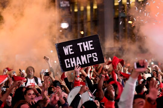 Raptors fans celebrate as they watch the broadcast of Game 6 at a viewing party outside Scotiabank Arena.