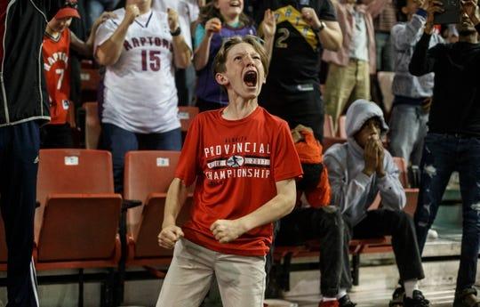 Fans in Edmonton, Alberta, cheer as they watch the Raptors beat the Warriors.