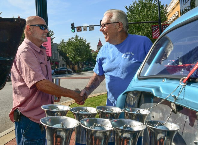 Frankie Crisp of Anderson, left, shakes hands with local racing legend Gene 'Moonlighter' Cromer of Anderson, near the 427 Ford engine in the 1941 Willys, shown during the Father's Day Main Street 20th Anniversary 2019 Car Show in downtown Anderson Saturday, June 15, 2019.