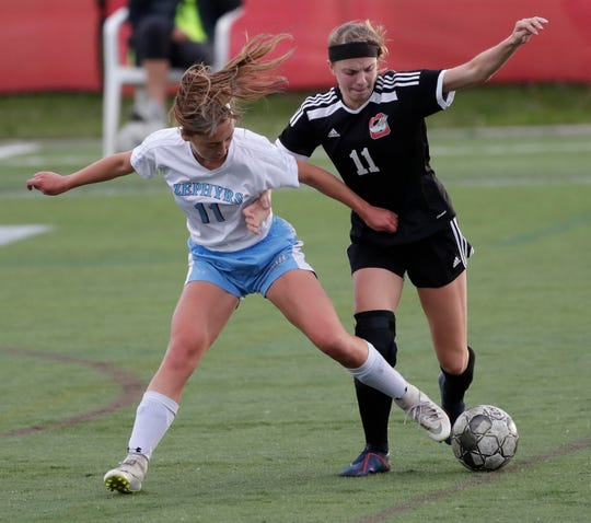 St. Mary Catholic's Emma Haeman (11) defends against Oostburg's Ashley Swihart (11) during their WIAA Division 4 state semifinal soccer game Friday in Milwaukee.