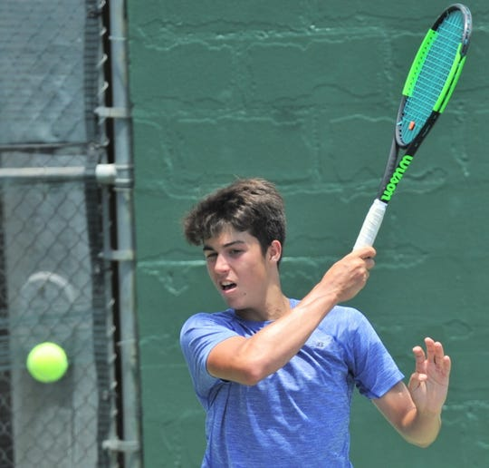 Austin's Marko Mesarovic returns a shot to San Antonio's Louis Cloud during their Boys 16 singles championship at the Texas Slam. Cloud won 6-1, 6-7 (5), 7-6 (4) on Saturday, June 15, 2019, at ACU's Eager Tennis Center.