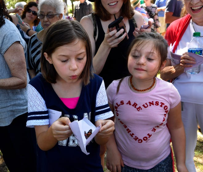 Sisters Katelynn (left) and Abbey Hazelip, ages 8 and 6, remember their late great-grandfather Don Hazelip by releasing a butterfly during Saturday's Butterfly in the Park Memorial Service. Sponsored by the West Texas Rehabilitation Center and Hospice for the Big Country, the annual event was held at Nelson Park's Festival Gardens.
