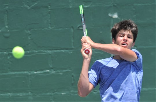 Austin's Marko Mesarovic eyes his return shot to San Antonio's Louis Cloud during the Texas Slam's Boys 16 singles title match. Cloud won the match 6-1, 6-7 (5), 7-6 (4) on Saturday, June 15, 2019, at ACU's Eager Tennis Center.