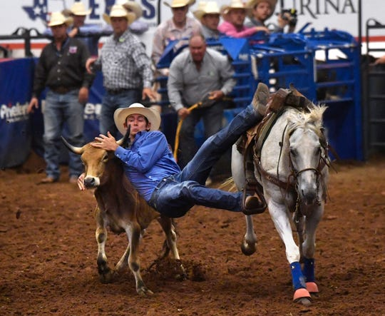 Tanner Woodard, of Iola, competes in steer wrestling during the 2019 Texas High School Rodeo Association Finals at the Taylor County Coliseum.