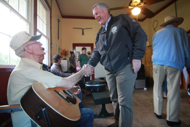 Congressmen Mark Meadows shakes hands with musicians inside The Depot in Marshall.