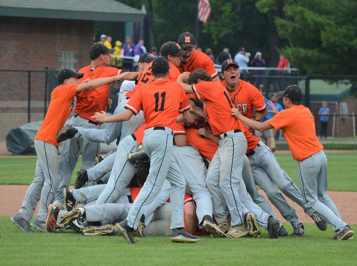 Homer celebrates winning the MHSAA Division 3 State Championship in baseball.