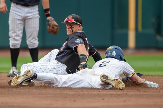 Jun 15, 2019; Omaha, NE, USA; Michigan Wolverines shortstop Jack Blomgren (2) steals second base ahead of the tag from Texas Tech Red Raiders infielder Brian Klein (5) in the second inning in the 2019 College World Series at TD Ameritrade Park . Mandatory Credit: Steven Branscombe-USA TODAY Sports
