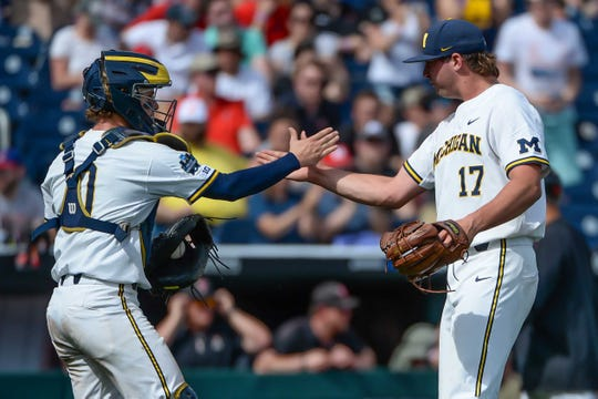 Jun 15, 2019; Omaha, NE, USA; Michigan Wolverines pitcher Jeff Criswell (17) and catcher Joe Donovan (0) celebrate the win against the Texas Tech Red Raiders in the 2019 College World Series at TD Ameritrade Park . Mandatory Credit: Steven Branscombe-USA TODAY Sports