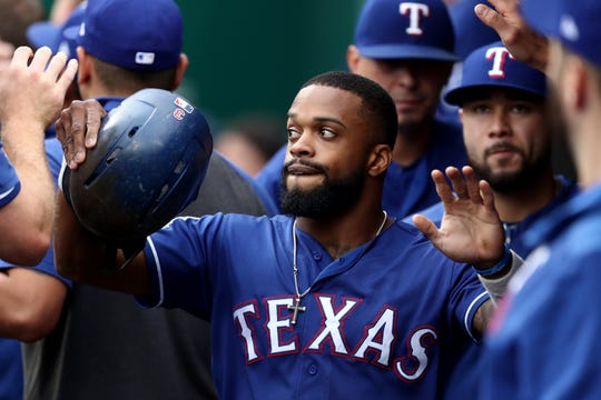 Texas Rangers left fielder Delino DeShields celebrates with teammates after scoring a run against the Cincinnati Reds in the first inning at Great American Ball Park on Friday, June 14, 2019.