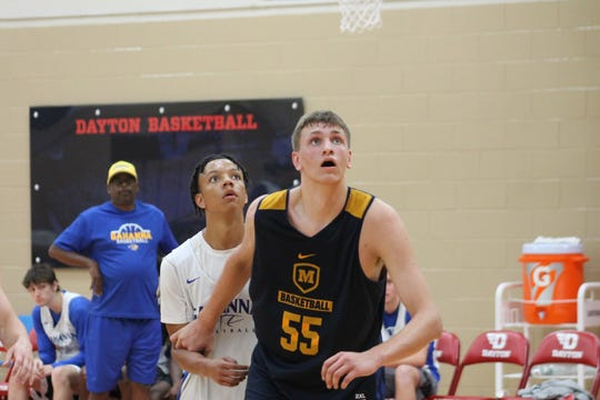 Moeller junior Logan Duncomb gets position for a rebound at Dayton Flyers team in June