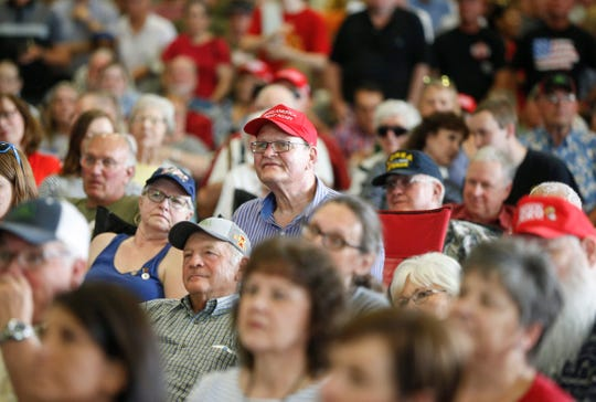 Supporters listen to U.S. Sen. Joni Ernst at the Central Iowa Expo in Boone on Saturday, June 14, 2019, during the fifth annual Roast and Ride.