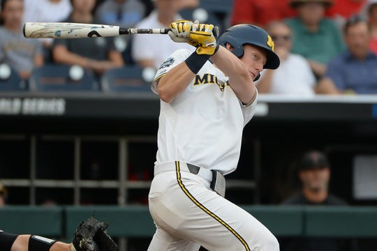 Michigan first baseman Jimmy Kerr triples in two runs in the third inning of the College World Series game on Saturday, June 15, 2019, in Omaha, Nebraska.