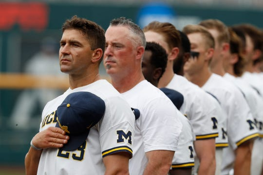 Michigan coach Erik Bakich observes the national anthem prior to the game against Texas Tech in the 2019 College World Series at TD Ameritrade Park on Saturday, June 15, 2019.