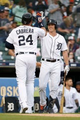 Detroit Tigers first baseman Miguel Cabrera (24) celebrates with left fielder Brandon Dixon (12) after hitting a solo home run during the second inning against the Cleveland Indians at Comerica Park on June 14, 2019 in Detroit, Michigan.