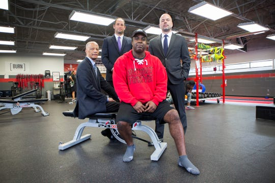 From left:  Mike Fox, seated, owner of Detroit Thrive fitness, is photographed with his civil rights attorneys Gerald Evelyn, Robert Higbee and Peter Alle at his gym in Grosse Pointe Woods, Mich., Thursday, June 6, 2019.  Fox was wrongly arrested a year ago by a Grosse Pointe Woods swat team raid w/K-9 for resembling black bank-robbery suspect, jailed for 48 hours, and cops still call him person of interest although they found real suspect.  Something about an unpaid parking ticket complicates this.