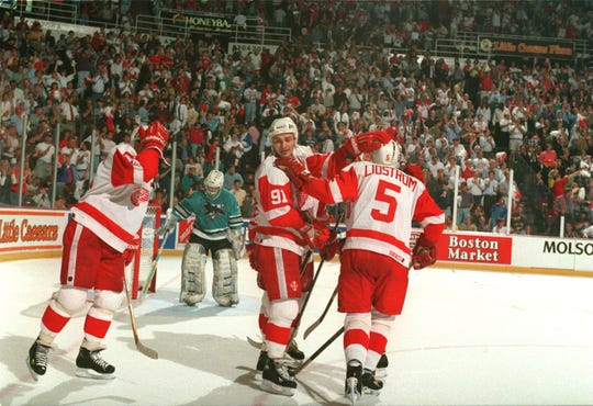 Sergei Fedorov (91) and Nicklas Lidstrom (5) celebrate a goal scored against the Sharks in the playoffs, May 23, 1995.