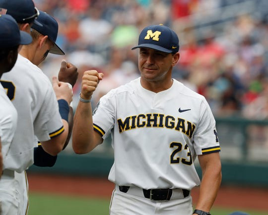 Michigan coach Erik Bakich greets his players prior to the game against Texas Tech in the 2019 College World Series at TD Ameritrade Park on Saturday, June 15, 2019.